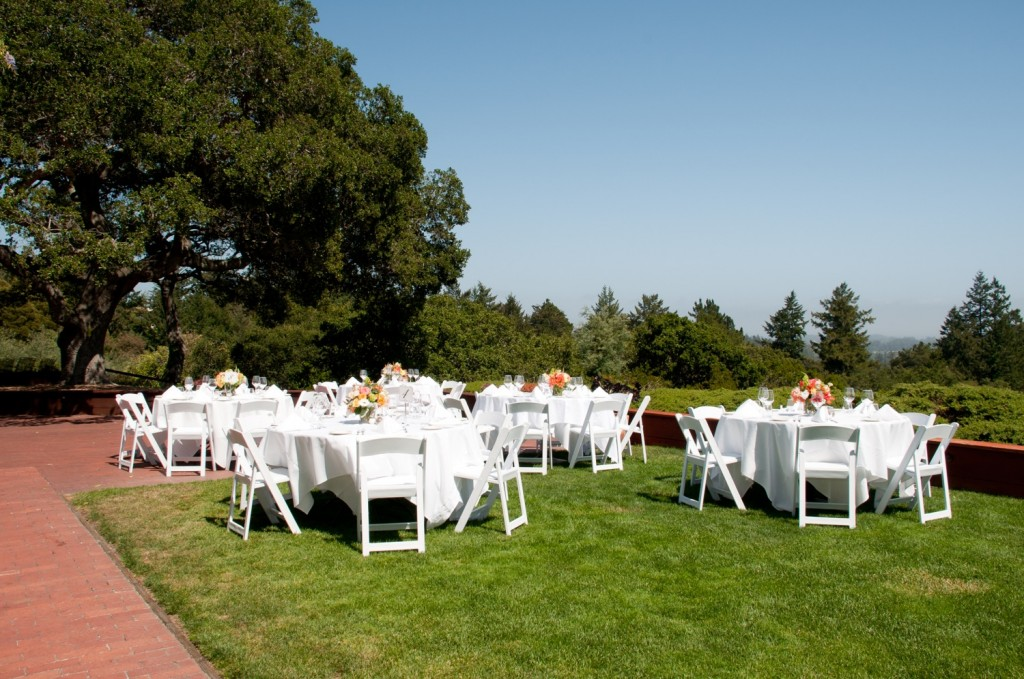 Tables set on a lawn for the reception.