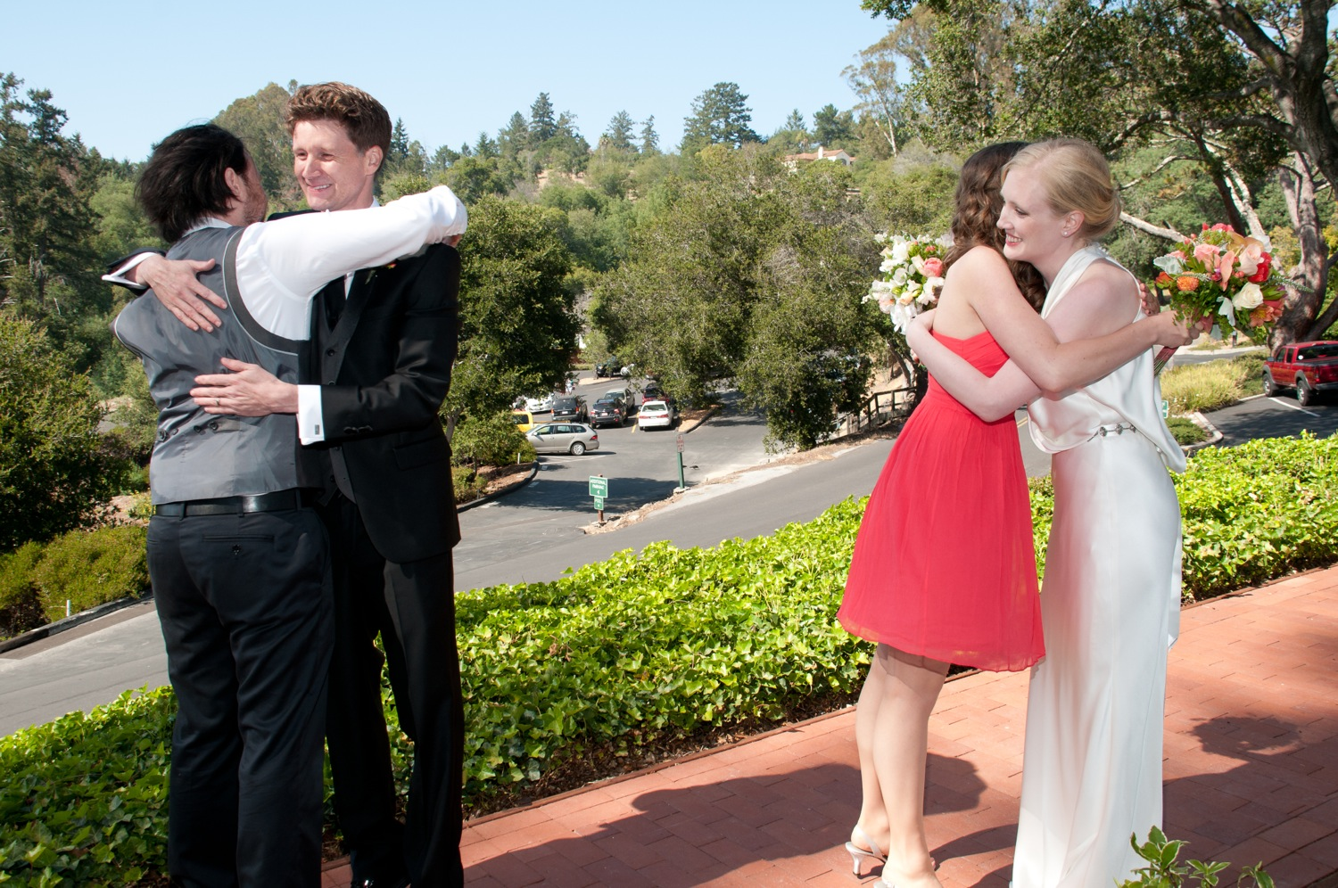 Jerram hugs his best man, Jerram and Elizabeth and Christine hug.  Really, there's a log of hugs.