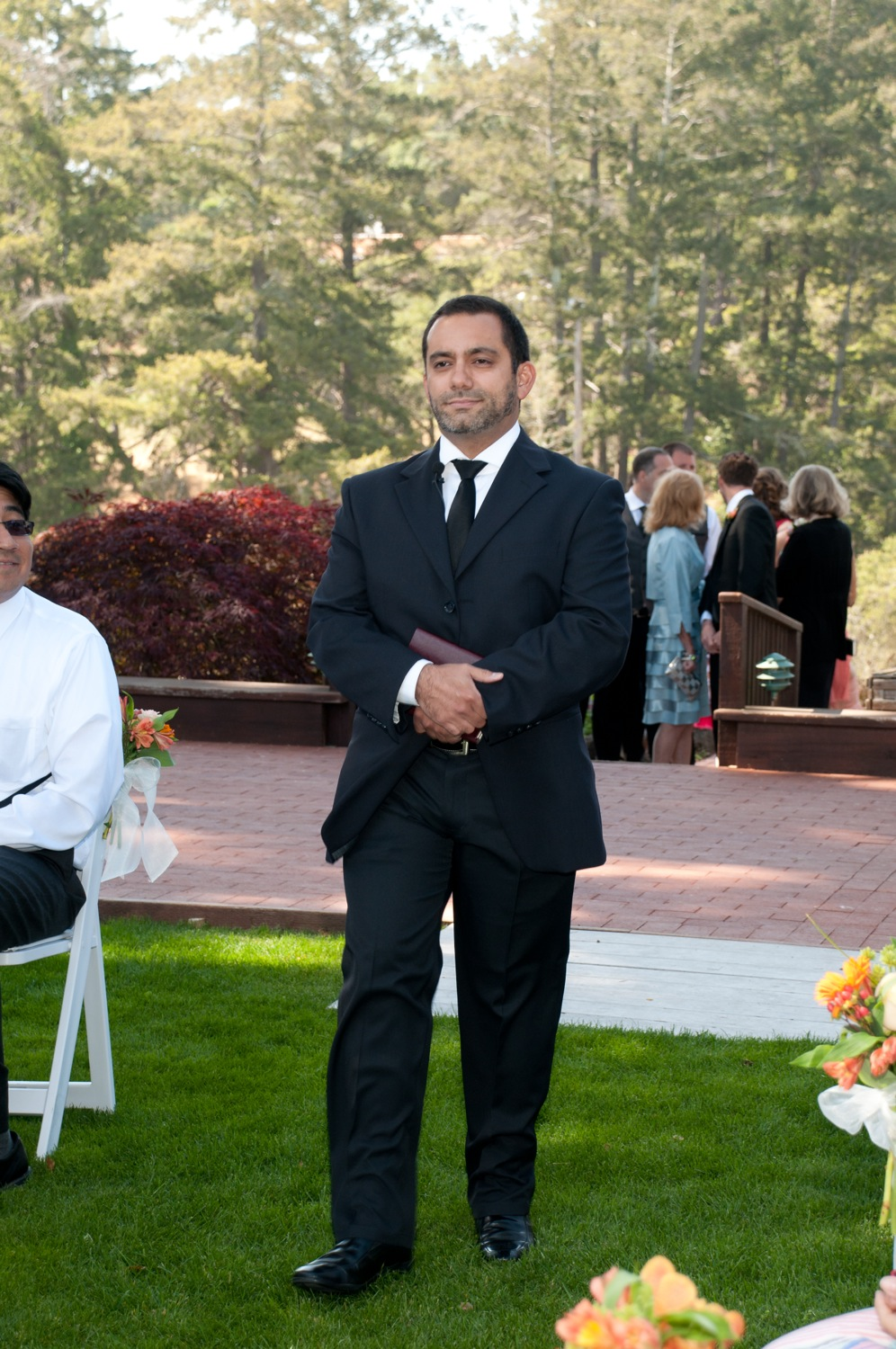 Christian, magician, performer, and our officiant, walks down the aisle.