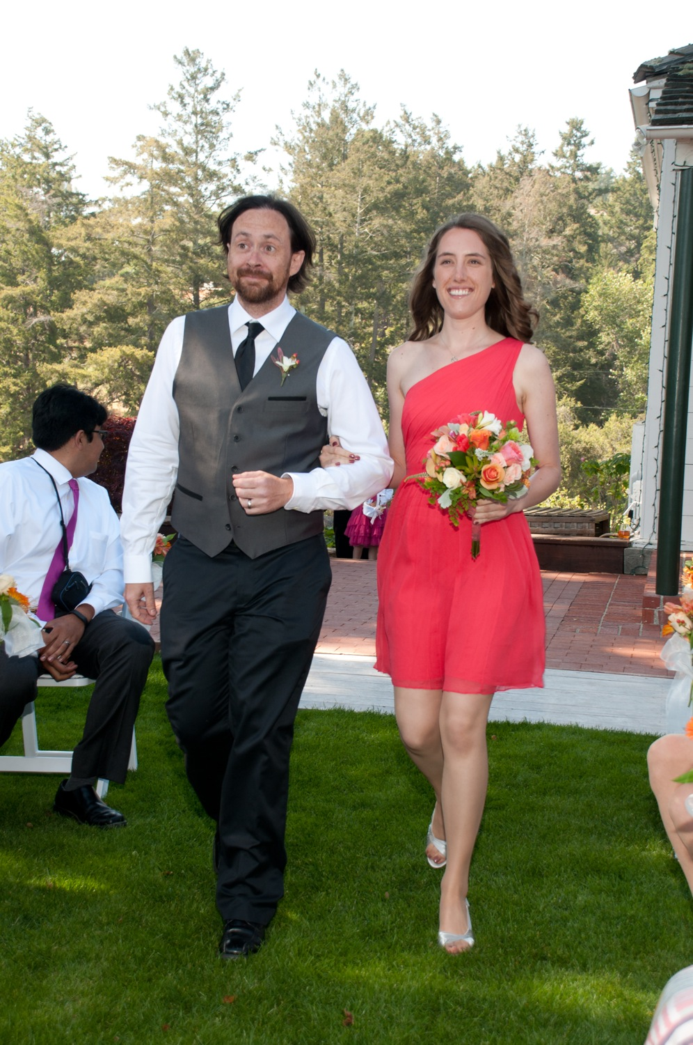 James, Jerram's best friend, and Christine, Elizabeth's sister, walk down the aisle.