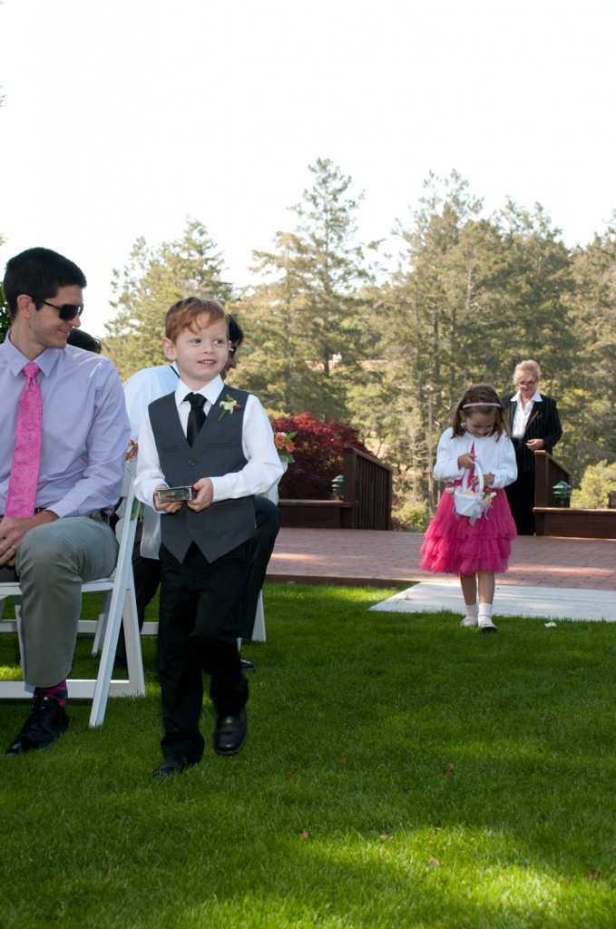 Twins Gretchen and Lazlo come down the aisle as ring bearer and flower girl.