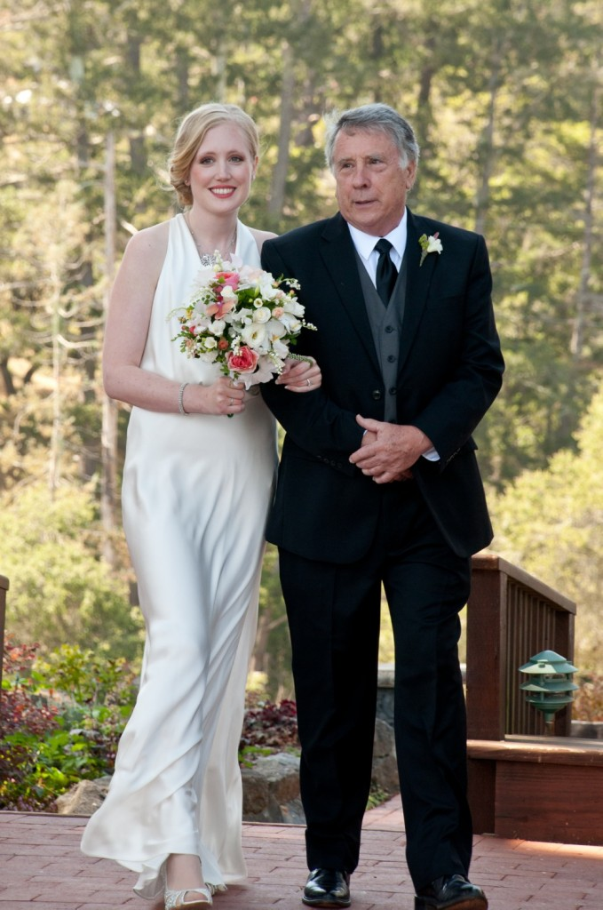 Elizabeth, escorted by her father, comes down the aisle.