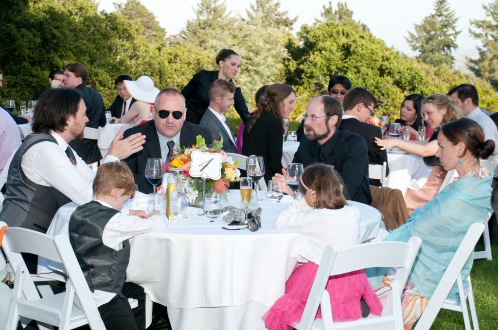 Guests sit down at their tables.